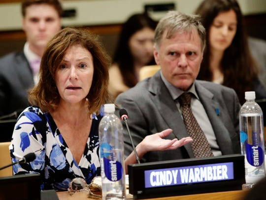 Fred Warmbier, right, listens as his wife Cindy Warmbier, speaks of their son Otto Warmbier, an American who died last year, days after his release from captivity in North Korea speaks during a meeting Thursday, May 3, 2018, at the United Nations headquarters. (AP Photo/Frank Franklin II)