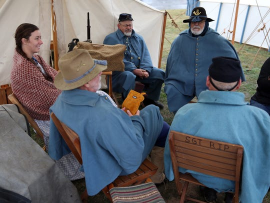 Reenactors huddle together, built fires and used heavy