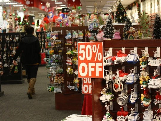 Shoppers hunt for after-Christmas bargains at a mall in Clarksville.