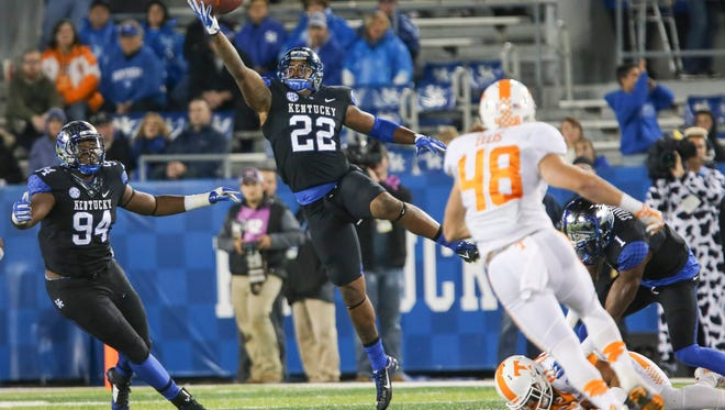 Kentucky linebacker Khalid Henderson intercepts a pass during the second half of an NCAA college football game against Tennessee, Saturday, Oct. 31, 2015, in Lexington, Ky. Tennessee won 52-21.