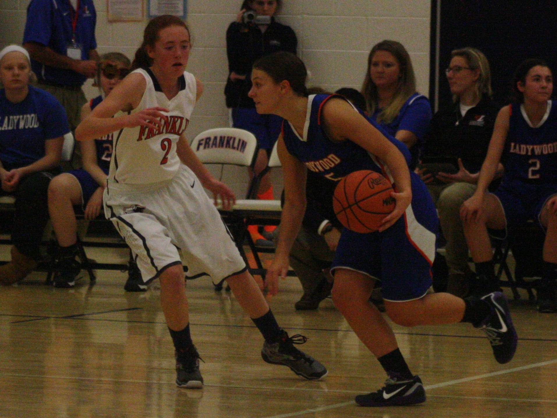 Ladywood's Kate Roney is defended by Franklin's Olivia Napier.