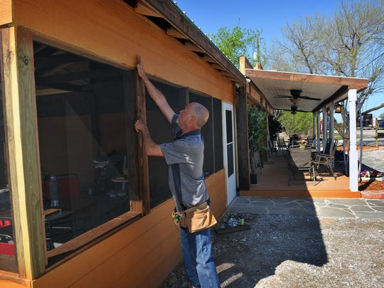 James Fee, a retired contractor, does some trim work on a screened patio on the restaurant he and his wife, Ellen, opened in Ringgold. The location was a former antiques and junk store right on Highway 82 and has been completely renovated and expanded into Fee's Knic Knacs Cafe.