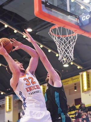 The Westchester Knicks' Marshall Plumlee, left, goes for a dunk during the home opener against the Greensboro Swarm.