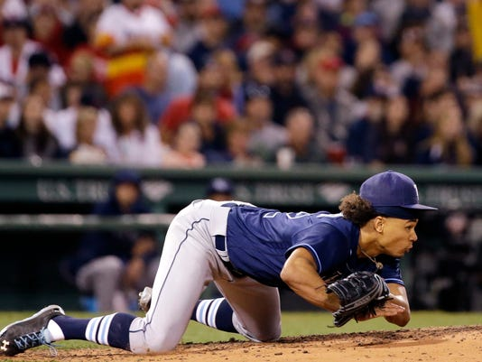 Tampa Bay Rays starting pitcher Chris Archer dives to the dirt trying to field a sharp ground single up the middle by Boston Red Sox's Hanley Ramirez in the sixth inning of a baseball game at Fenway Park, Friday, July 8, 2016, in Boston. (AP Photo/Elise Amendola)
