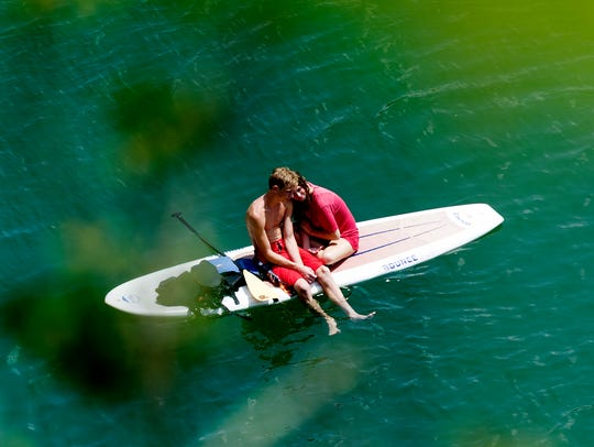 A couple enjoys an intimate moment on their paddle