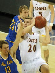 Cooper's Blaine Walters shoots over NCC sophomore Paul Kremer during a Ninth Region boys basketball quarterfinal between Newport Central Catholic and Cooper March 1, 2018 at BB&T Arena, Highland Heights KY.