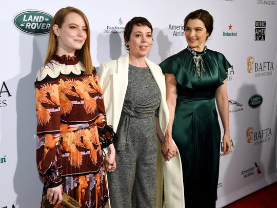 "Emma Stone, from left, Olivia Colman, and Rachel Weisz, cast members in the film ""The Favourite,"" pose together at the 2019 BAFTA Tea Party at the Four Seasons Hotel in Los Angeles."