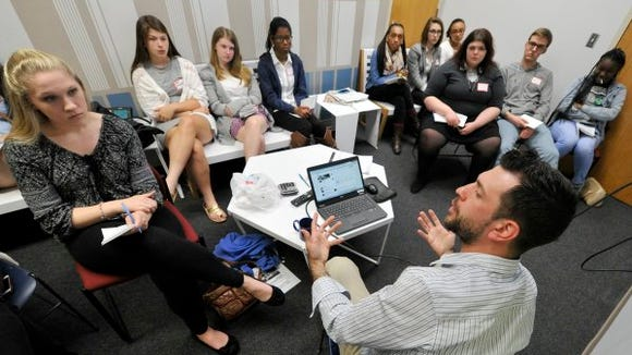 York Daily Record reporter Mark Walters talks with high school students in the annual YDR Journalism Workshop.