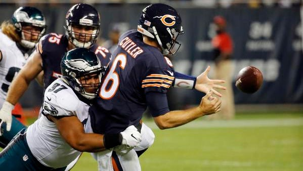 Chicago Bears quarterback Jay Cutler (6) fumbles as he is tackled by Philadelphia Eagles defensive tackle Destiny Vaeao (97) during the second half of an NFL football game, Monday, Sept. 19, 2016, in Chicago.