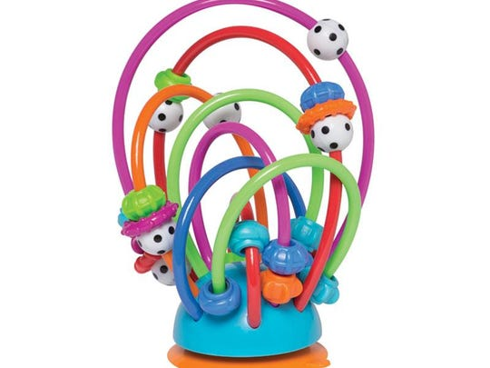 The round plastic beads in Manhattan Toy Co.'s Busy Loops table top toy can break, posing a choking hazard.