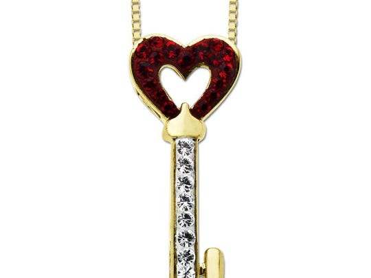 Suit up for business in essentials with a twist. Luminesse 18-karat gold over sterling silver red key pendant with Swarovski Elements, $38 at Walmart. (Gannett/File)