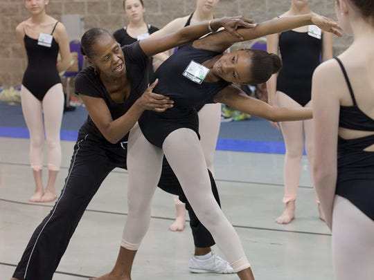 Dianne Maroney-Grigsby, choreographer for Orchesis Dance Company and Louisiana Dance Theatre, instructing a young dancer.
