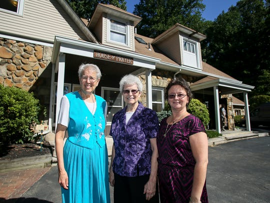 The Mount Saint Mary House of Prayer in Mountainside celebrates its 40th anniversary in 2016. From left, Sister Eileen Smith, RSM, director of the house, Sister Mary Jo Kearns, RSM, and Sister Laura Arvin, OP, co-directors, pose in front of the building on August 24, 2016.