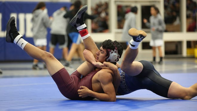 Rancho Mirage wrestles against Beaumont in a dual at Cathedral City High School, November 30, 2016.