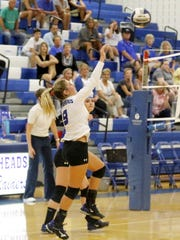 All-state pick Avery Snyder serves the ball for Horseheads