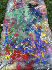 One of two large pieces of art created by students inspired by the Abstract Expressionism works and techniques of Jackson Pollock during Tuesday's Art in the Park program at the Hopewell Culture National Historic Park.