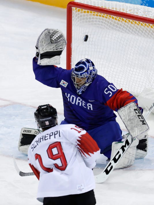 Reto Schaeppi (19), of Switzerland, shoots the puck past goalie ParkSungje (50), of South Korea, for a goal during the third period of the preliminary round of the men's hockey game at the 2018 Winter Olympics in Gangneung, South Korea, Saturday, Feb. 17, 2018. (AP Photo/Julio Cortez)