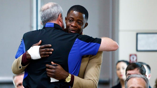 James Shaw gets a hug from Waffle House CEO Walt Ehmer during a press conference on the Waffle House shooting Sunday, April 22, 2018 in Nashville, Tenn. (Photo by Wade Payne, Special to the Tennessean)