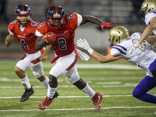 Centennial's Zidane Thomas rushes against Notre Dame