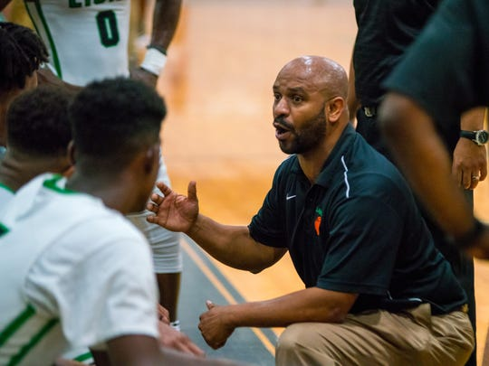 Lafayette's head coach Clifton Brown encourages his players during a timeout as the Mighty Lions take on the Dutchtown Griffins in a playoff game on Friday Feb. 23, 2018.