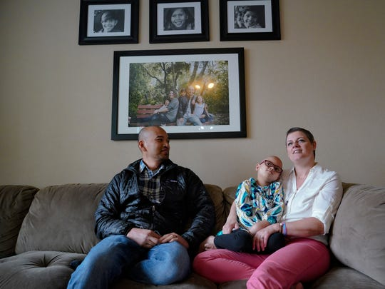 Six-year-old Kalea Ramos cuddles with her parents, Angie and Mike, at the family's Chula Vista home Thursday, May 24, 2018. A rare diagnosis of mixed-phenotype leukemia has forced Ramos, who has undergone multiple rounds of chemotherapy, to launch a worldwide search for a bone marrow donor who is a good match with her Filipino and Caucasian heritage. (Nelvin C. Cepeda/San Diego Union-Tribune/TNS)