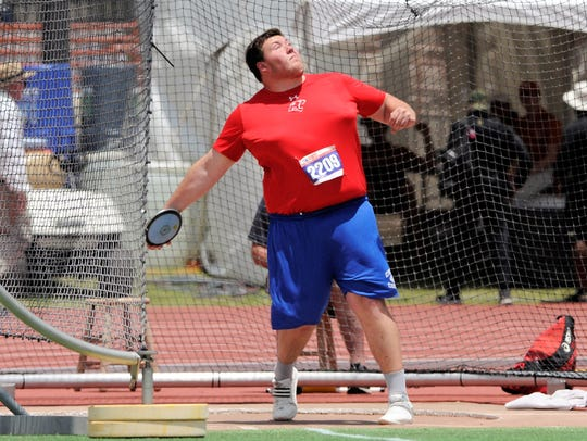 Cooper's McCord Whitaker prepares to throw during the Class 5A boys discus at the UIL State Track and Field Championships at the University of Texas' Mike A. Myers Stadium in Austin.