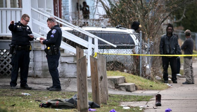 Police Investigate a shooting on Wilkins Street on March 14, 2016.