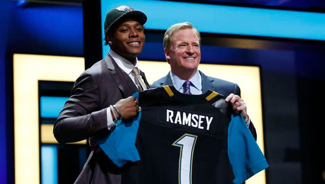 Florida State's Jalen Ramsey, a Smyrna native and former Brentwood Academy star, stands with NFL commissioner Roger Goodell after being selected by the Jacksonville Jaguars with the fifth overall pick in the NFL draft.