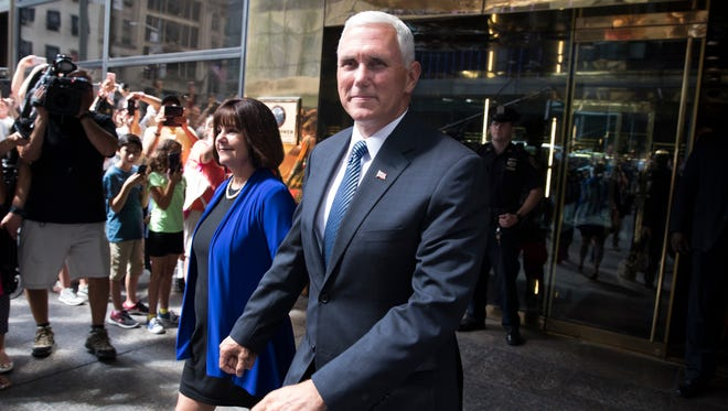 Gov. Mike Pence and his wife, Karen, leave a meeting with Donald Trump at Trump Tower in New York on Friday.
