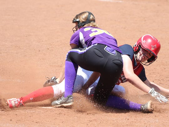 Pacelli High School's Sophie Schroeder slides safely into home to score their lone run against Juda/Albany High School Saturday, June 10, 2017 during the WIAA Division 4 State Softball Tournament Finals in Madison, WIs.