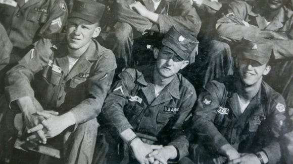 Bill Pisula (center) with other military members.