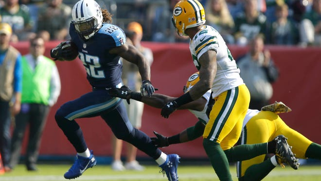 Tennessee Titans running back Derrick Henry (22) gets past the Packer defense during the Green Bay Packers 47-25 loss to the Tennessee Titans during the NFL football game at Nissan Stadium in Nashville, Tennessee, Sunday, November 13, 2016.