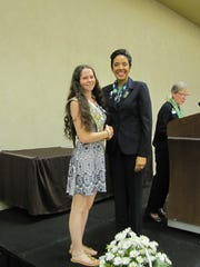 Molly Oney presented the Girl Scout Gold Award by Girl