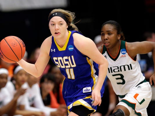 South Dakota State guard Madison Guebert (11) dribbles past Miami guard Jessica Thomas (3) in the second half of a first-round women's college basketball game in the NCAA Tournament Saturday, March 19, 2016, in Stanford, Calif.  South Dakota State won 74-71. (AP Photo/Marcio Jose Sanchez)