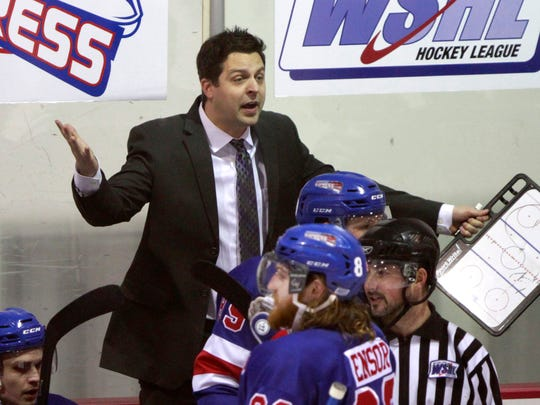 Springfield Express hockey coach Jeremy Law argues with a referee during a game against the Wichita Jr. Thunder at Mediacom Ice Park on Feb. 13.