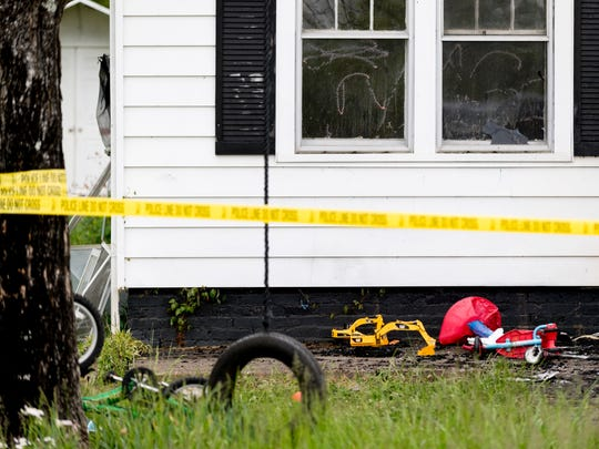 Children's toys outside of the home at the scene of an overnight house fire at 885 Wright Road in Alcoa, Tennessee on Sunday, April 22, 2018.