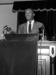 The Rev. Martin Luther King Jr. speaks at a mass meeting
