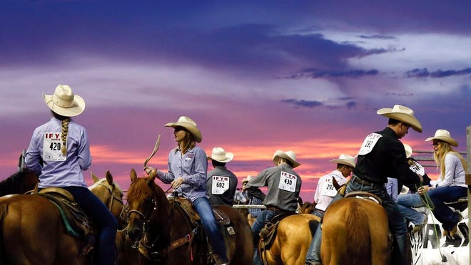 The sun sets during the International Finals Youth Rodeo at the Heart of Oklahoma Exposition Center in Shawnee, Okla., Monday evening, July 8, 2019. The 2020 rodeo will not be held because of the COVID-19 pandemic.