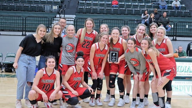 Members of the Plainview Lady Indians basketball team pose together after winning the consolation championship Saturday at the Port City Classic in Catoosa.