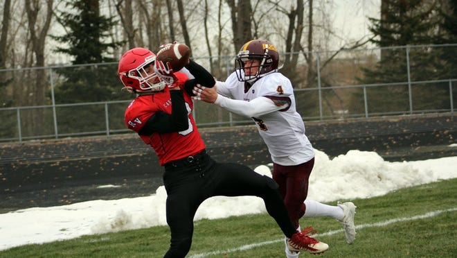 Carter Peterson of Redwood Valley hauled in the game's first touchdown Saturday against Blue Earth Area.