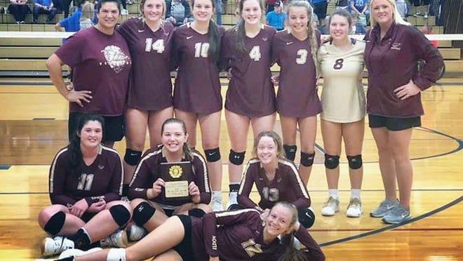 The Eldon volleyball team celebrates its Fulton Tournament Championship on Saturday, September 12, in Fulton.