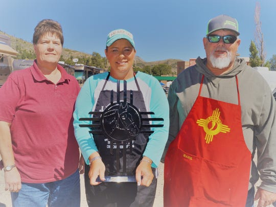 New Mexico state champions of the 2017 Aspenfest State Open Chili Cook-Off left to right:  Kim Cox from Alamogordo, third place; Brandy Reid from Hobbs, first place; and Mark Smith from Hobbs, second place.