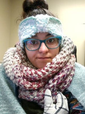 In this Thursday, Jan. 4, 2018, selfie photo provided by Rebecca Miller, Miller, an academic adviser at Tennessee State University, wears sweaters, a scarf, ear coverings, gloves and a blanket over her lap while she works at her desk in Holland Hall on campus in Nashville, Tenn. Many office workers find they still have to brave the cold even after they escape the frigid outdoors during the extremely cold winter weather. (Rebecca Miller via AP)