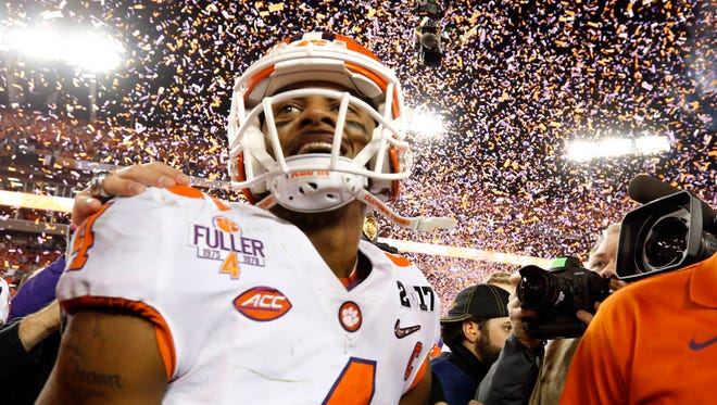 Jan 9, 2017: Clemson Tigers quarterback Deshaun Watson (4) celebrates after defeating the Alabama Crimson Tide in the 2017 College Football Playoff National Championship Game at Raymond James Stadium.
