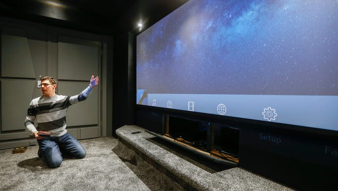 """Patrick Williams talks about the aspect ratio of his """"Star Wars""""-themed home theater at his home in Nixa."""