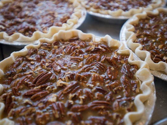 Pecan pies sit ready for baking at Me Oh My Coffee