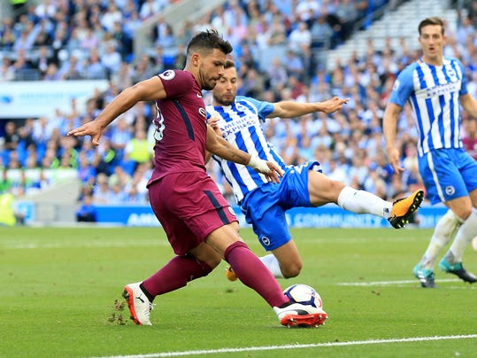 Manchester City's Sergio Aguero, left, and Brighton & Hove Albion's Markus Suttner battle for the ball during the Premier League soccer match Brighton and Hove Albion's versus Manchester City at the AMEX Stadium, Brighton, England, Saturday Aug. 12, 2017. (Gareth Fuller/PA via AP)