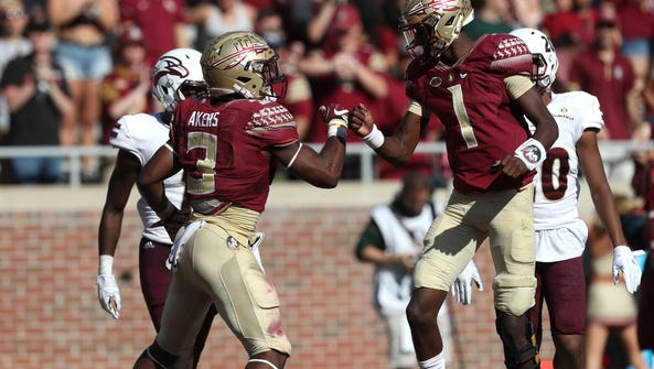 FSU's Cam Akers celebrates his touchdown with James