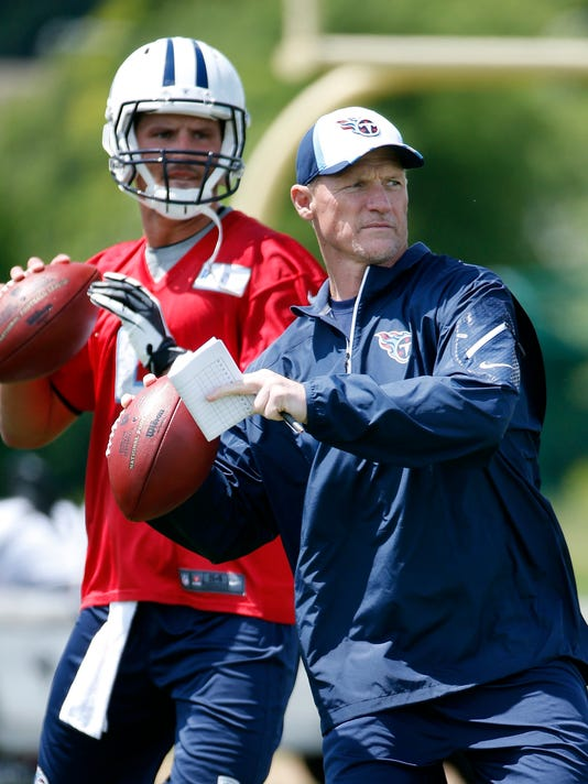 ADVANCE FOR WEEKEND EDITIONS, JULY 19-20 - FILE - In this May 16, 2014, file photo, Tennessee Titans head coach Ken Whisenhunt throws to a receiver along with tryout quarterback Drew Allen, left, during NFL football rookie minicamp in Nashville, Tenn. Whisenhunt, who helped turn Arizona into a Super Bowl team, landed in Tennessee and might have the best shot at fast improvement if he can get the offense to click. That's his specialty. (AP Photo/Mark Humphrey, File)