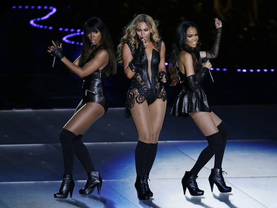 Beyonce, center, performs with Kelly Rowland, left,